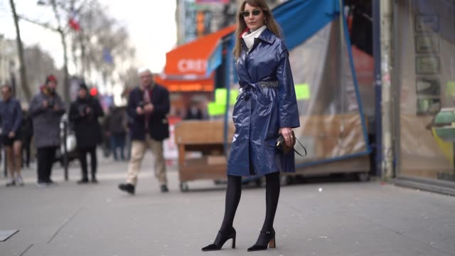 ece sukan wears a blue pvc trench coat during paris fashion week womenswear fall/winter 2018/2019 on march 3 2018 in paris france - coat stock videos & royalty-free footage
