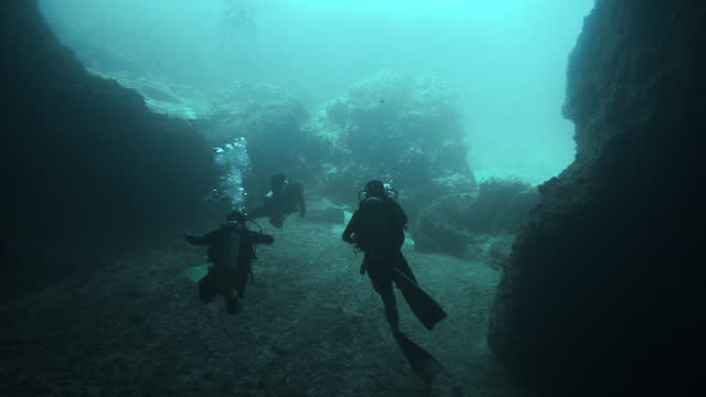 eco tourist friends scuba diving spelunking caves in southeast asia - andaman sea stock videos & royalty-free footage