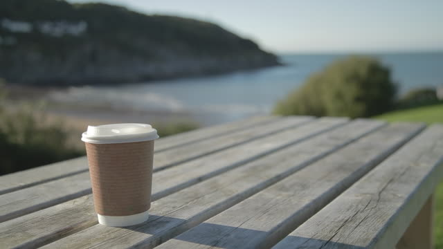 eco-friendly paper cup / uk - stationary process plate stock videos & royalty-free footage