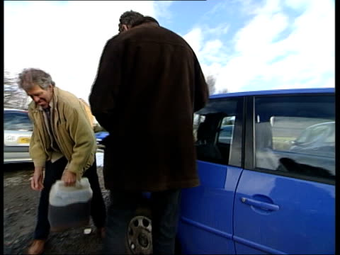 first nominee alastair sawday with austin talking about publishing books sot alastair sawday with austin filling up diesel tank of car with chip fat... - 環境メディア賞点の映像素材/bロール