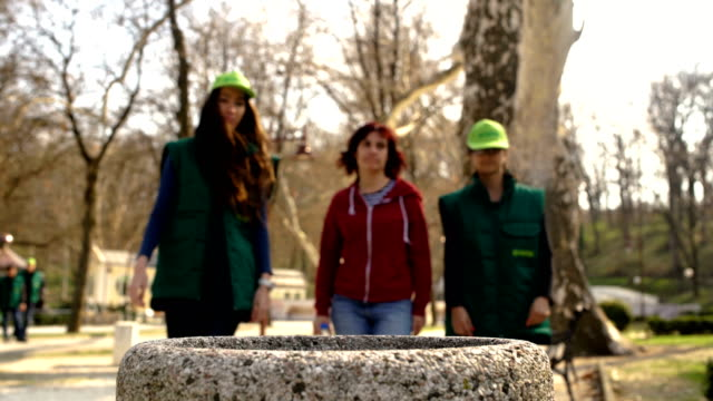 Ecology police- team of young student girls warn an rude  woman