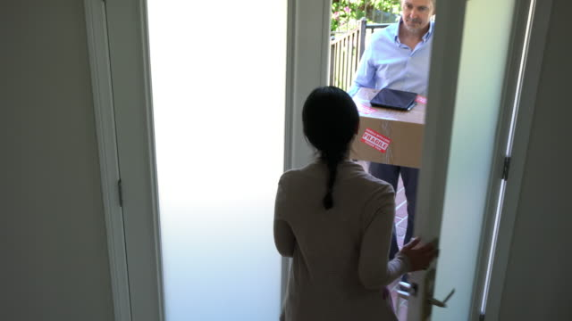 e-commerce package delivery home hispanic women opening door - receiving stock videos & royalty-free footage