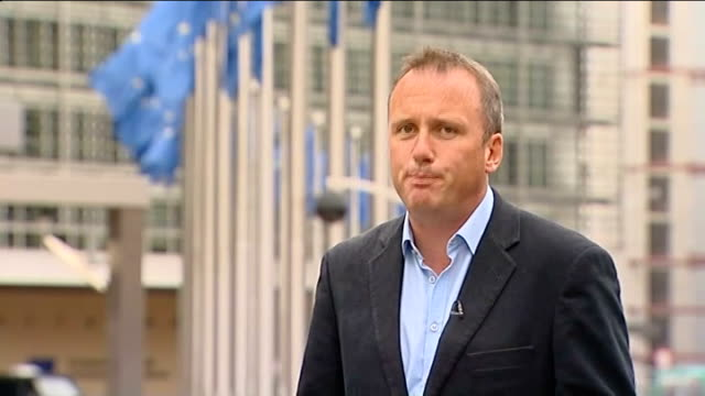 France and Germany call for urgent agreement on bail out package BELGIUM Brussels EXT Reporter to camera SOT