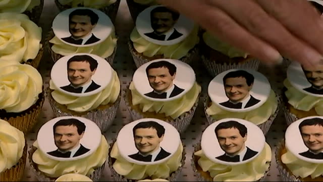 economic growth best since 2007; england: sussex: worthing: int speeded up sequence cupcakes decorated with face of chancellor george osborne mp ends... - worthing点の映像素材/bロール