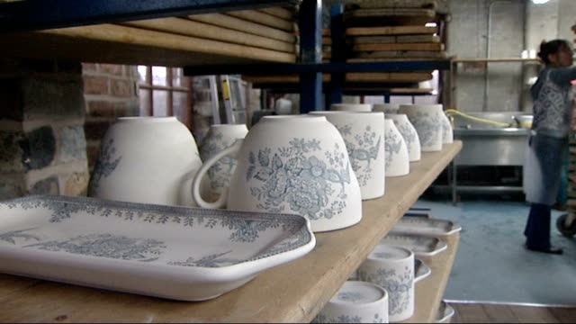 ceramics industry in stoke on trent; graphicised sequence - general view of burleigh pottery factory as it changes from b/w to colour burleigh... - steeple stock videos & royalty-free footage
