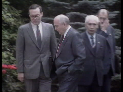 economic summit soviet aid kensington soviet embassy extms gates of soviet embassy with people seen in driveway ms gorbachev and others standing then... - official car stock videos & royalty-free footage
