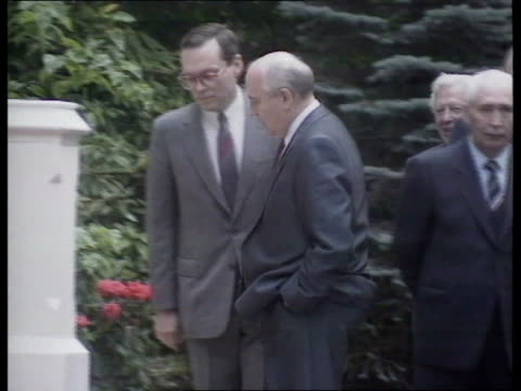economic summit soviet aid kensington soviet embassy ms gates of soviet embassy with people seen in driveway ms gorbachev and others standing then... - official car stock videos & royalty-free footage