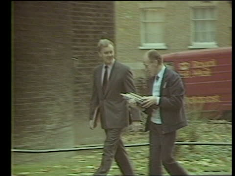 Autumn Financial Statement ENGLAND London Downing Street K CMS Douglas Hurd out of car along in BV to No 10 ZOOM IN as others accompany John Moore...