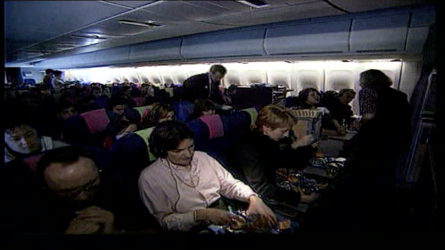 economy class syndrome: judge rules in favour of court action; itn lib from server ???: inside plane business class plane passengers sitting in plane... - air vehicle stock-videos und b-roll-filmmaterial
