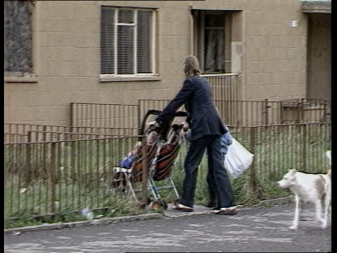 glasgow slums scotland glasgow easterhouse gv easterhouse estate pan lr ms woman pushing pushchair rlk gv boarded up flats on estate pan lr gv... - unemployment stock videos and b-roll footage