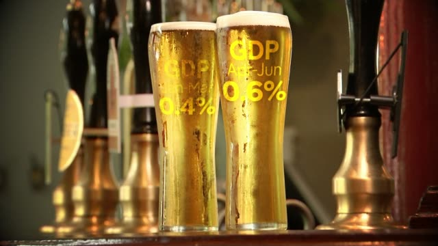 economy grew 0.6 per cent in the run up to the brexit vote; various shots drinks being servied and people eating at table graphicised sequence pint... - lager stock videos & royalty-free footage