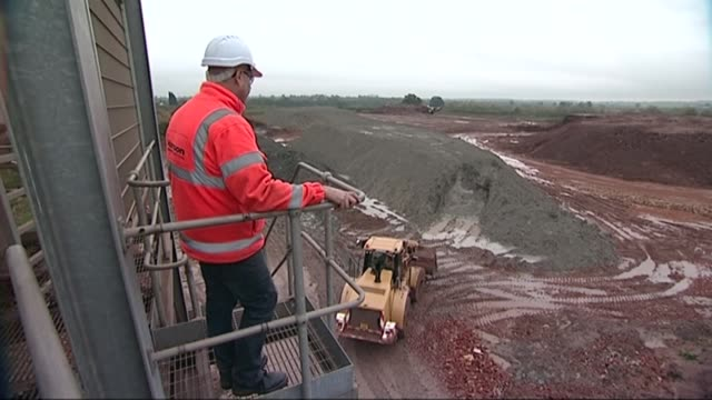 uk economy grows in second quarter of the year r13111303 / measham hanson brick factory ext construction worker looking out over quarry various shots... - construction vehicle stock videos and b-roll footage