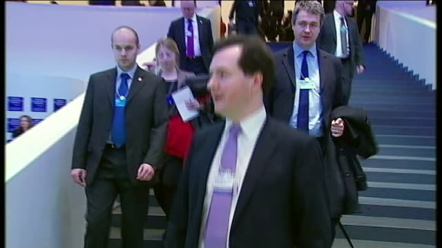 UK economy heading for triple dip recession 2412012 Davos George Osborne MP down stairway with others at World Economic Forum