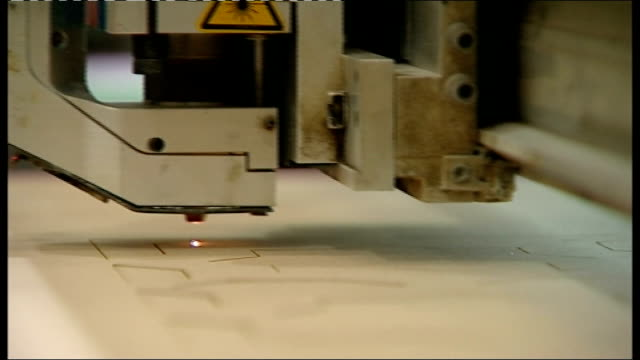 economy heading for triple dip recession; england: west yorkshire: barnsley: cutting technologies: int various of laser machine on cutting... - laser stock videos & royalty-free footage