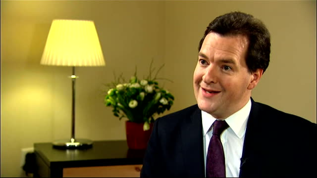 economy heading for triple dip recession; switzerland: davos: int george osborne mp interview sot - britain faces a difficult economic situation /... - 画面切り替え カットアウェイ点の映像素材/bロール
