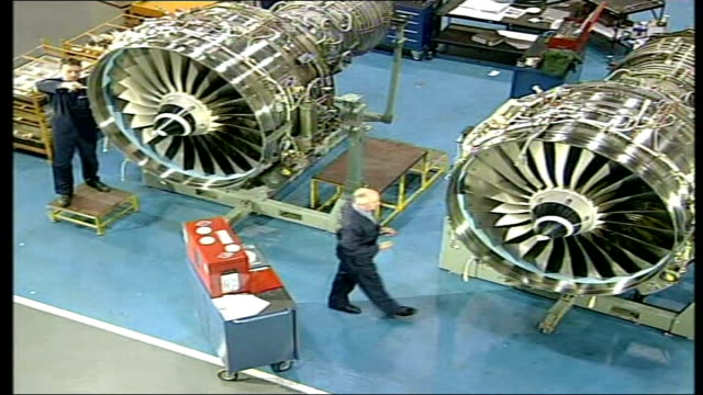open for business int high angle shot workers working on aircraft engines in rolls royce plant - rolls royce stock videos & royalty-free footage