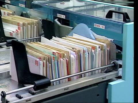 vídeos y material grabado en eventos de stock de post office new postal charges for early delivery nat harry smith mail on conveyor in sorting office mail being sorted by machine in sorting office... - formato buzón