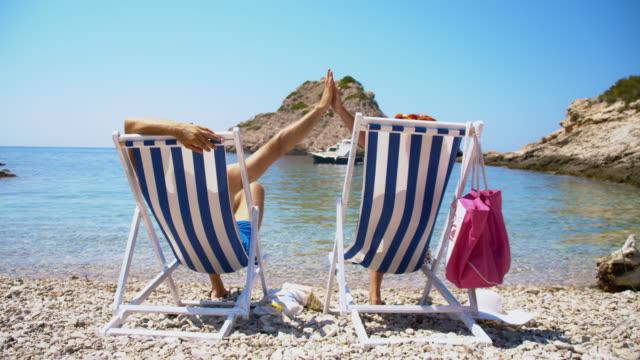 ecstatic couple relaxing on idyllic beach - croatia stock videos & royalty-free footage