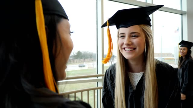 ecstatic female high school graduate celebrates with friend - female high school student stock videos & royalty-free footage