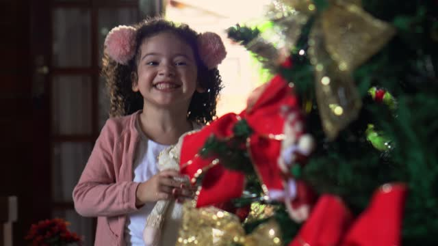 ecstatic little girl decorating the christmas tree - 2 3 years stock videos & royalty-free footage