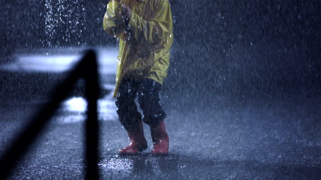 ecstatic little girl in the rain - raincoat stock videos & royalty-free footage