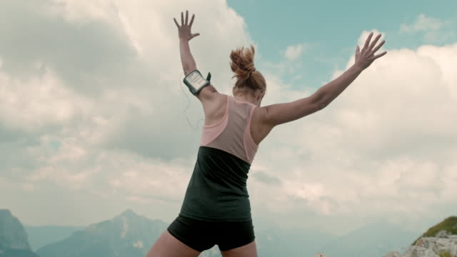 slo mo ecstatic woman jumping in joy - super slow motion stock videos & royalty-free footage