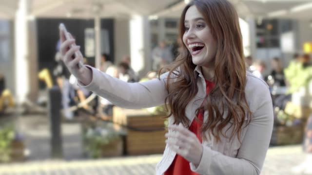 ecstatic young woman, phone celebration joy.. - winning stock videos & royalty-free footage