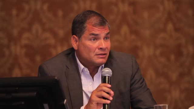 ecuadorian head of state president rafael correa talks to journalists inside presidential palace and refers to reelection soundbite - ecuadorian ethnicity stock videos and b-roll footage