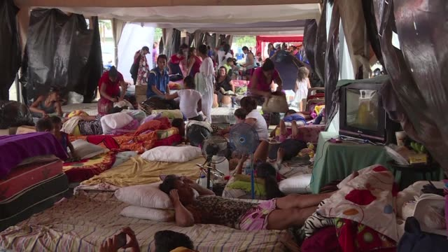 ecuadorians displaced by the earthquake take refuge in an unused airport in portoviejo with one resident commenting that its not a five star hotel... - ecuadorian ethnicity stock videos and b-roll footage