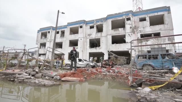 Ecuador's attorney general and interior minister on Sunday visited the police barracks where a car bomb attack injured 28 people