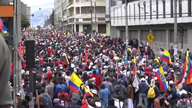 ecuador's indigenous march through the streets of quito to protests against soaring fuel prices slashed oil output by a third and forced under fire... - ecuador stock videos & royalty-free footage