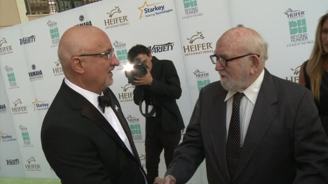 ed asner and pierre ferrari heifer international hosts 3rd annual beyond hunger a place at the table gala at montage beverly hills on august 22 2014... - montage beverly hills video stock e b–roll