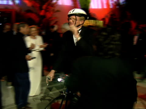 stockvideo's en b-roll-footage met ed bagley jr. rides a bike down the red carpet at the vanity fair oscar party. - oscar party