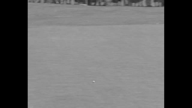 ed dudley putts and misses hole by three feet / england's alf perry has long put and misses by inches / gene sarazen sinks putt / ws of green lined... - pga event stock videos and b-roll footage