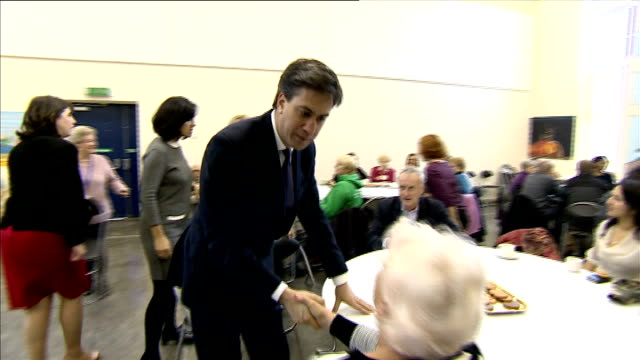 ed miliband and caroline flint visit lunch club in hulme england manchester photography*** ed miliband mp and caroline flint mp enter building and... - ed miliband stock-videos und b-roll-filmmaterial