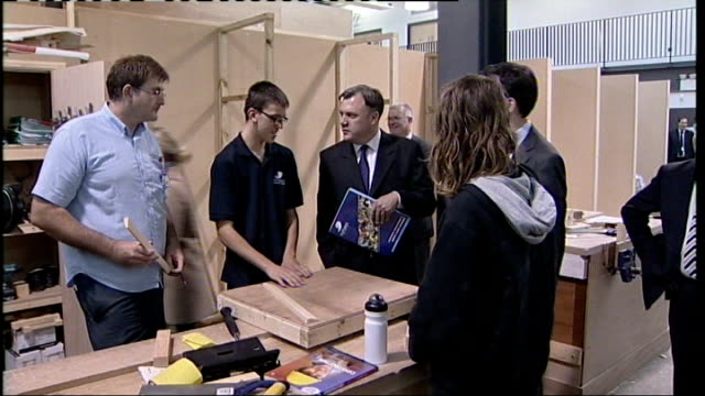 ed miliband and ed balls visit futures community college in southend miliband and balls visiting woodwork workshop / miliband and balls chatting to... - ed miliband stock-videos und b-roll-filmmaterial
