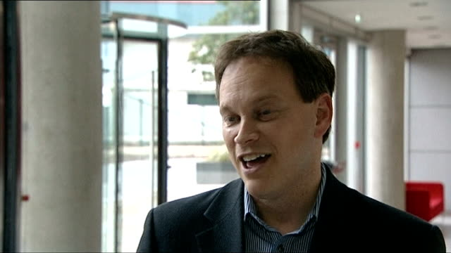 ed miliband can't promise a reversal of austerity measures under a labour government london int grant shapps mp seen through window entering building... - grant shapps stock videos and b-roll footage