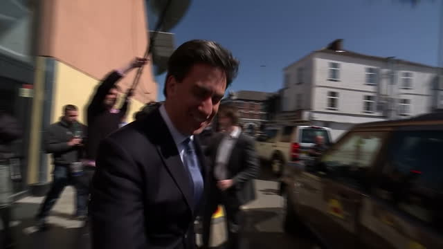 ed miliband continues labour election campaign in the north east shows exterior shots ed miliband walking from arc theatre in stockton and being... - イングランド カウンティ・ダラム点の映像素材/bロール