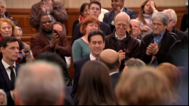 Ed Miliband defends his leadership of Labour ENGLAND London PHOTOGRAPHY** Ed Miliband MP arriving in room to applause SOT Ed Miliband MP speech SOT...