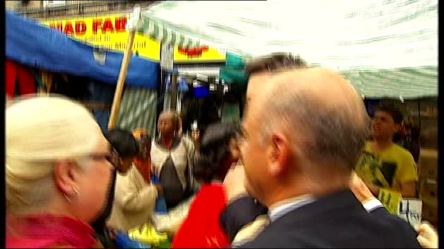 ed miliband egged during market walkabout england london walworth ext various shots ed miliband mp along on tour of market and struck by egg and... - intercepting stock videos and b-roll footage
