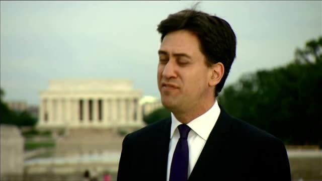 ed miliband interview in washington; usa: washington dc: ext ed miliband mp interview sot miliband and douglas alexander mp along - ダグラス アレキサンダー点の映像素材/bロール