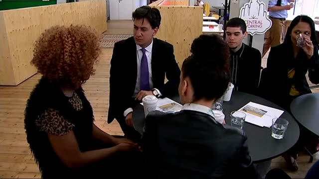 ed miliband launches new welfare policy england london int ed miliband mp taking seat with group of young people around table various shots of... - t in the park stock-videos und b-roll-filmmaterial