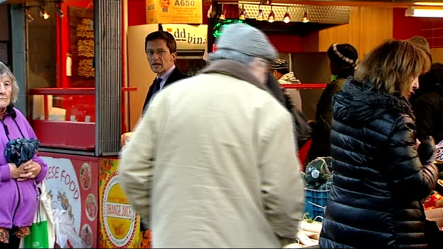 ed miliband outlines new labour party proposals on immigration tooting market ext various shots of people along street legs of people along reporter... - vox populi stock-videos und b-roll-filmmaterial