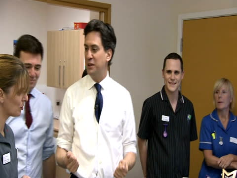Ed Miliband pledges to increase NHS nurse training ENGLAND Warwickshire Nuneaton EXT Ed MIliband MP arrives by car at George Eliot Hospital shakes...