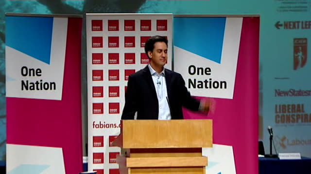 ed miliband pledges to introduce national register of rental property owners england london photography** ed miliband along to podium miliband... - itv weekend lunchtime news点の映像素材/bロール