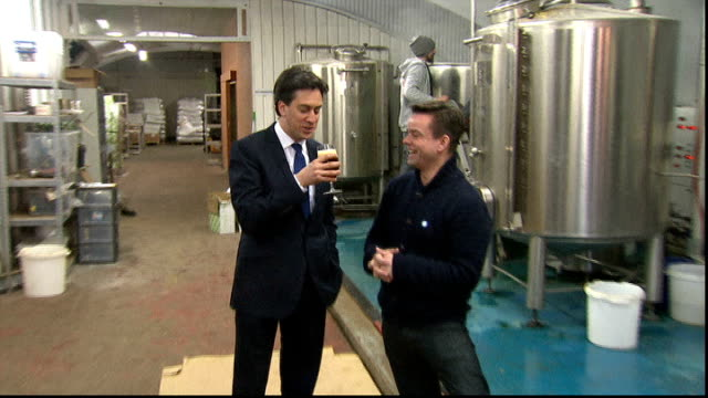 ed miliband promises to be a consumer champion as prime minister lib / tx london int ed miliband mp being handed glass of beer on visit to micro... - ed miliband stock-videos und b-roll-filmmaterial