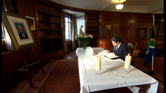 ed miliband signing the book of condolence for nelson mandela - politics icon stock videos & royalty-free footage