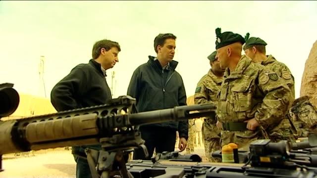 ed miliband visits troops in helmand province ed miliband mp and douglas alexander mp chatting with british troops at base camp - basläger bildbanksvideor och videomaterial från bakom kulisserna