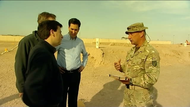 ed miliband visits troops in helmand province; ed miliband mp and douglas alexander mp chatting with british officer - douglas alexander stock videos & royalty-free footage