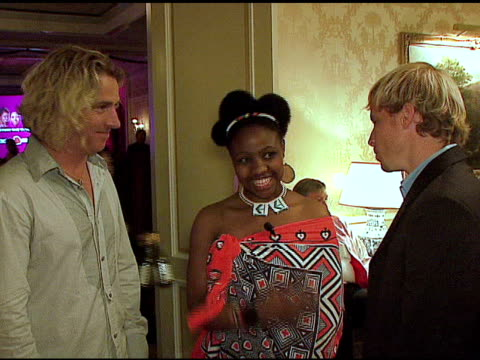 Ed Roland Philile Gumbi and Brian Littrell at the Sara Blakely Foundation 'Give a Damn' Party at Ritz Carlton in Atlanta Georgia on October 15 2006